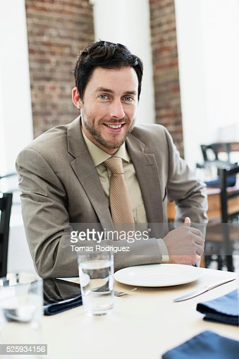 Businessman sitting in restaurant : Stockfoto