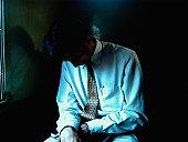 Businessman sitting in shadows