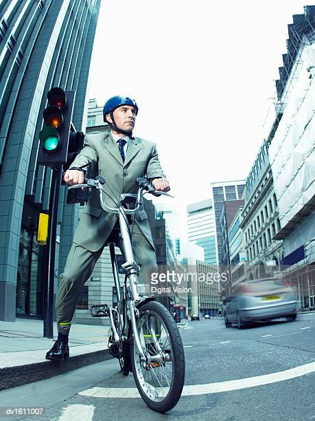 Businessman Sitting on a Bicycle