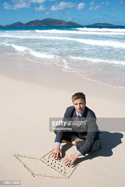 Businessman Sitting on Beach Typing with Sand Laptop