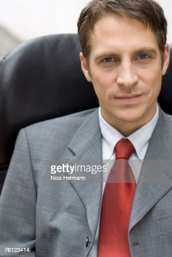 Businessman sitting on chair, portrait, close-up : Stock Photo