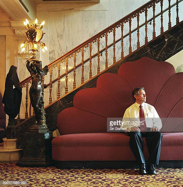 Businessman sitting on couch in lobby