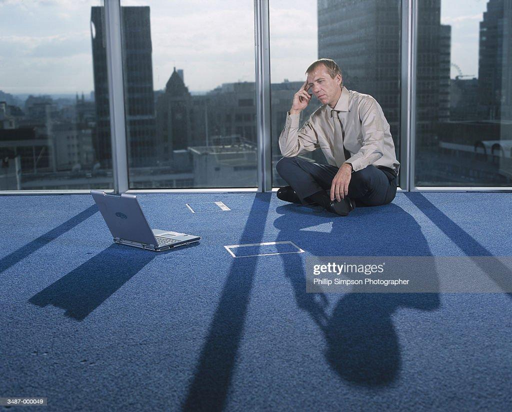 Businessman Sitting on Floor : Stock Photo