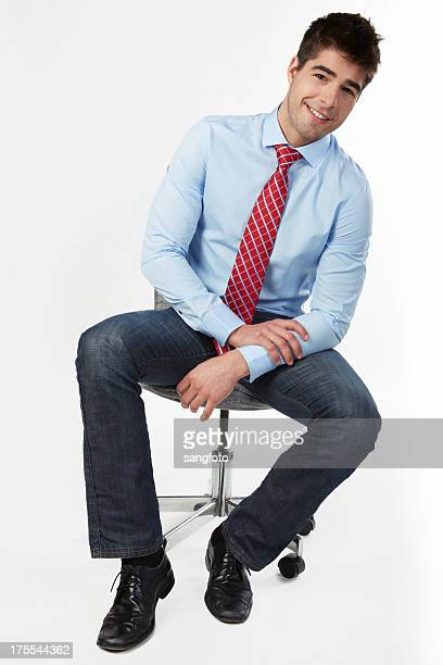 Businessman sitting on office chair smiling