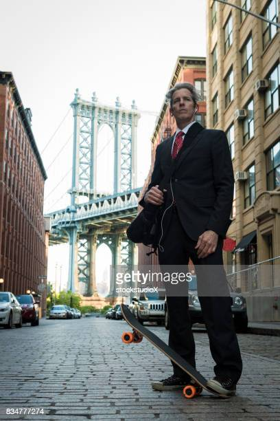 Businessman skateboarding  in New York