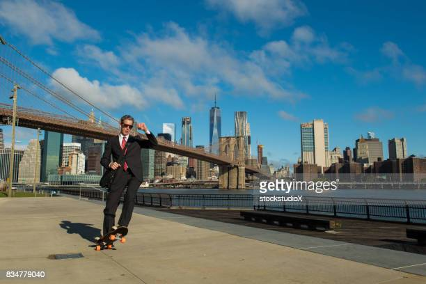 Businessman skateboarding