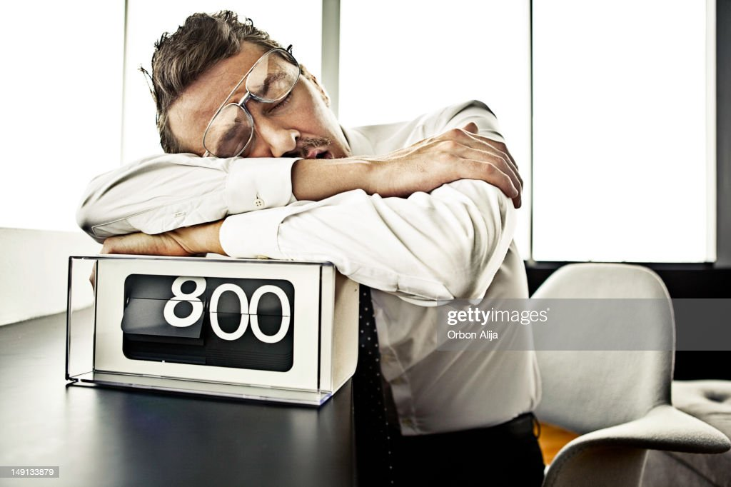 Businessman sleeping at the office : Stock Photo