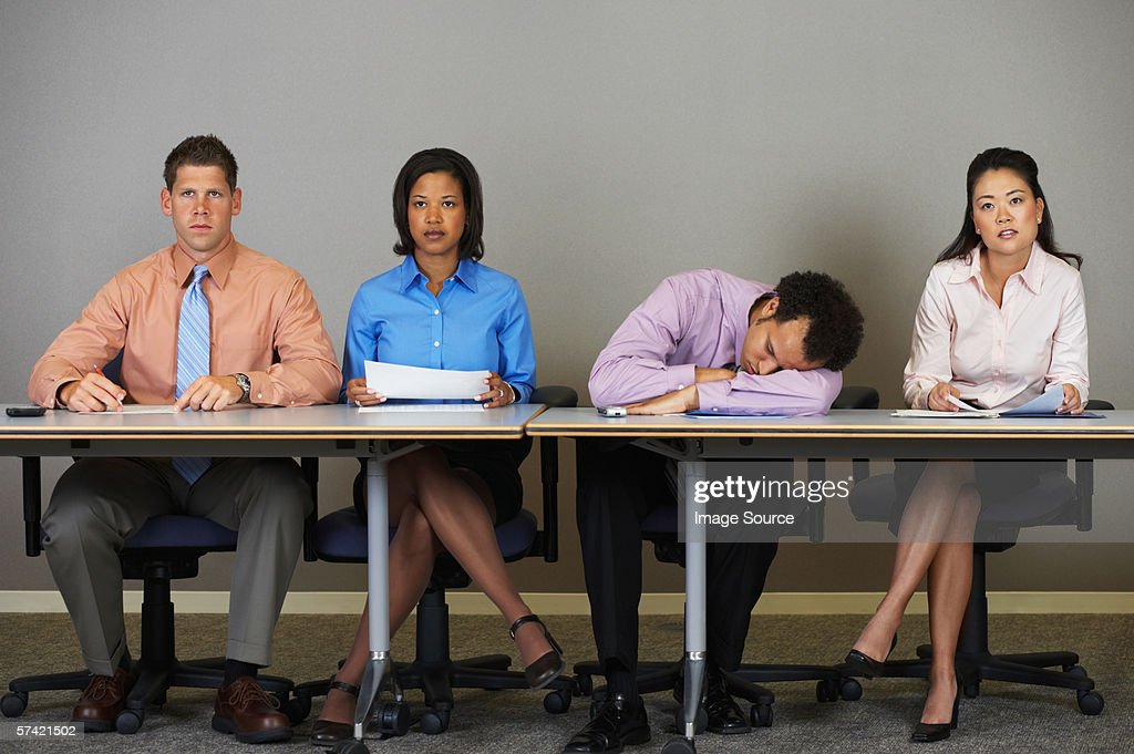 Businessman sleeping during a meeting : Stock Photo