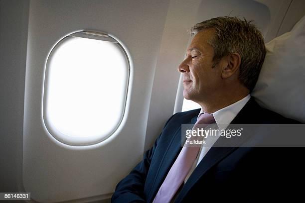 A businessman sleeping on a plane