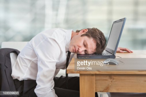 Businessman sleeping on laptop : Stock Photo