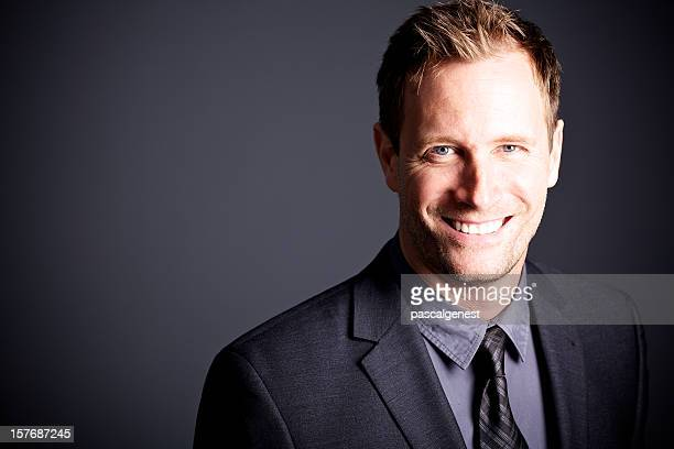 Businessman smiling and looking at camera