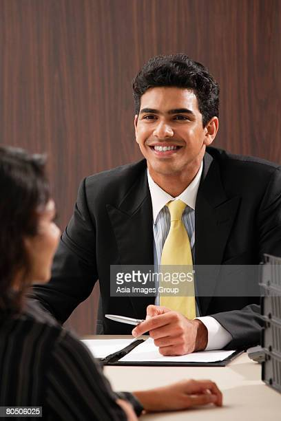 Businessman smiling at woman