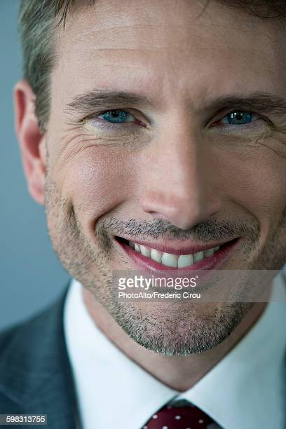 Businessman smiling cheerfully, portrait