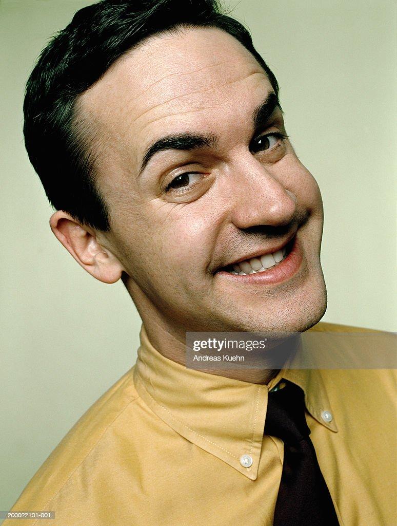 Businessman smiling, close-up, portrait : Stock Photo
