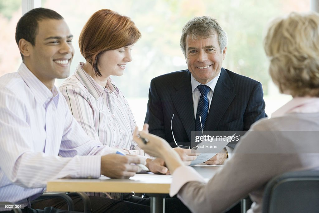 Businessman smiling in a conference : Stock Photo