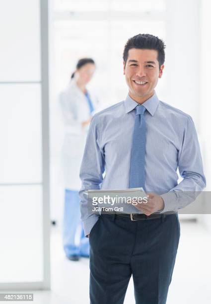 Businessman smiling in hospital