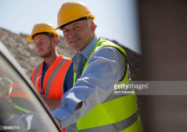 Businessman smiling in quarry