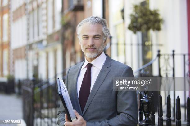 Businessman smiling on city street
