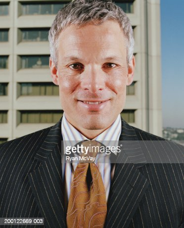 Businessman smiling, portrait, close-up : Stock Photo