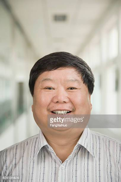 Businessman smiling, portrait, close-up