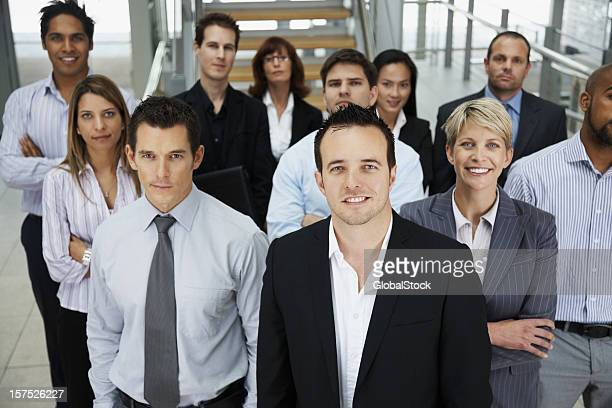 Businessman smiling with colleagues at the back