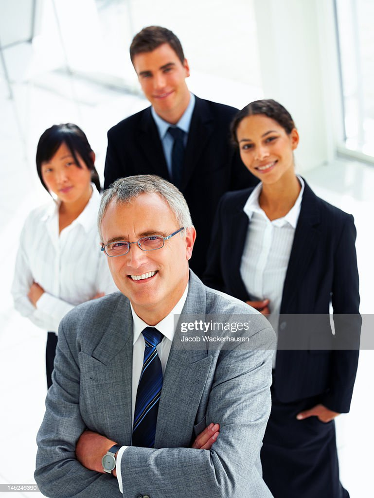 Businessman smiling with his colleagues