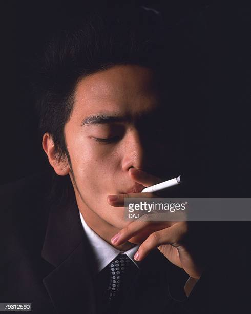 A businessman smoking, Front View