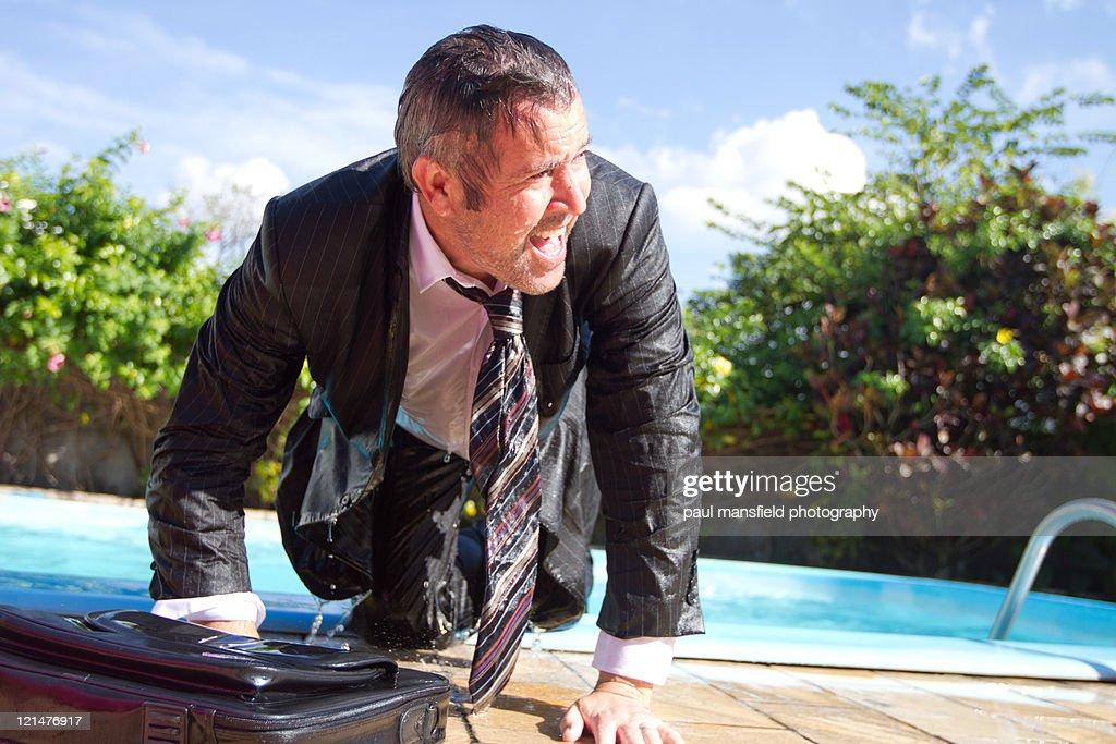 Businessman soaking wet