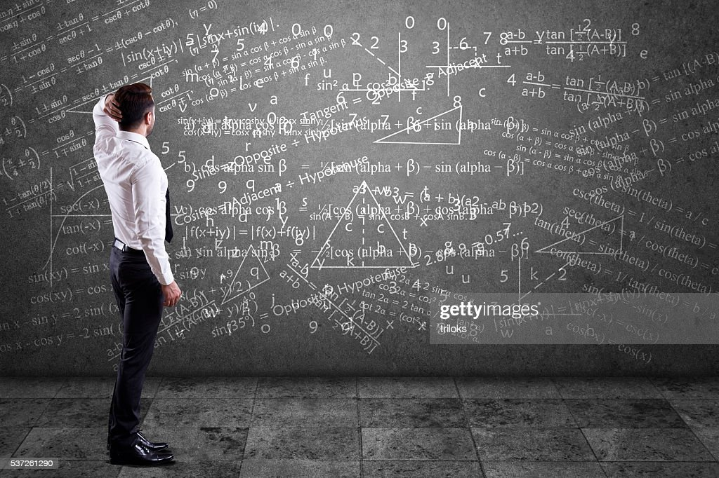 Businessman solving mathematical equation : Stock Photo