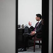 Businessman speaking to an unseen man