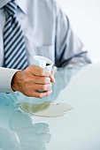 Businessman squeezing a coffee cup