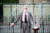 Businessman standing in a fountain