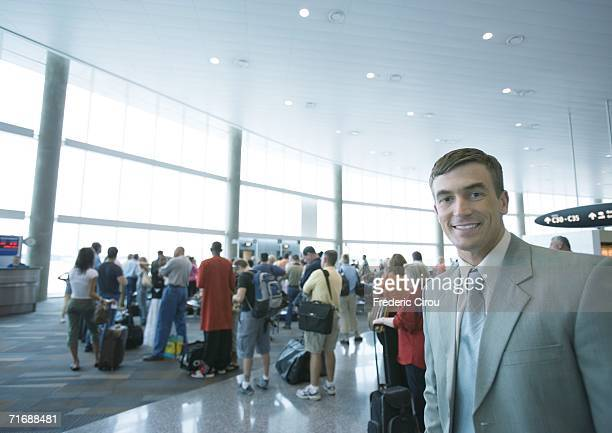 Businessman standing in airport boarding area