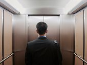 Businessman standing in an elevator