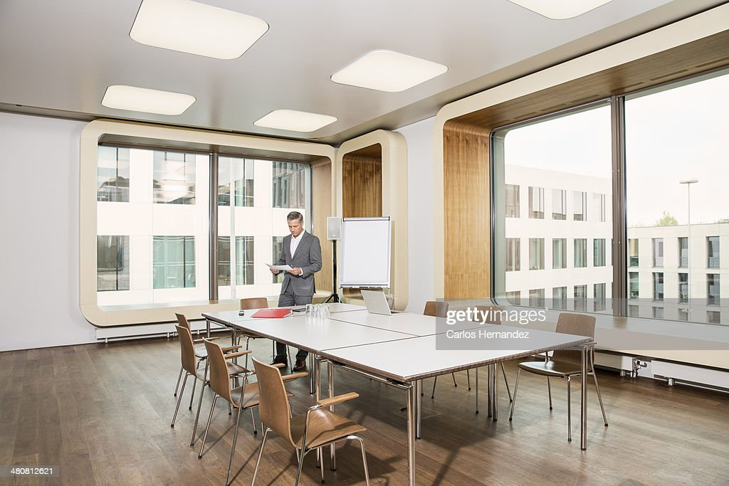 Businessman standing in conference room : Stock Photo