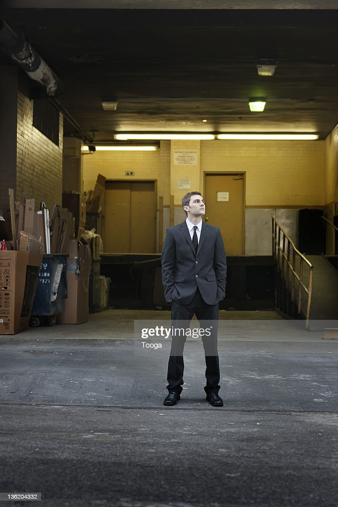 Businessman standing in front of loading dock : Stock Photo