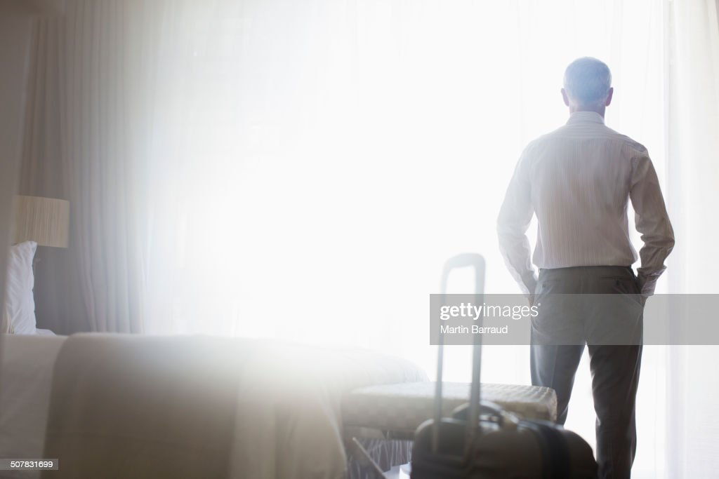 Businessman standing in hotel room
