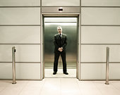 Businessman standing in office lift