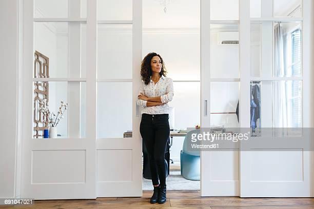 Businessman standing in office looking sideways