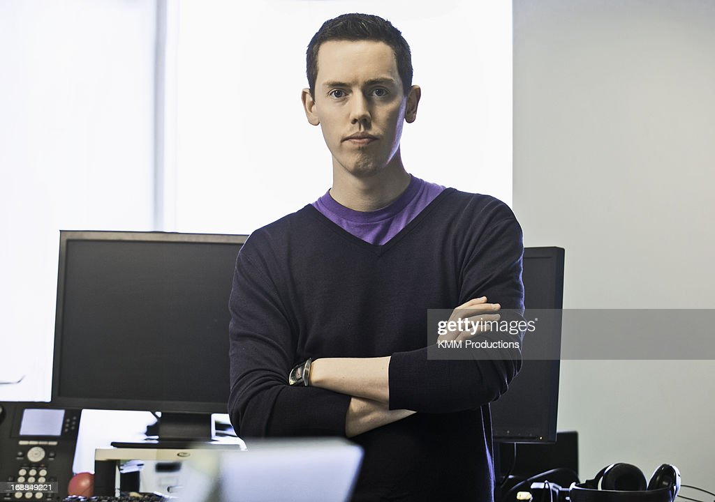 Businessman standing in office : Stock Photo