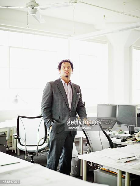 Businessman standing in office workstation