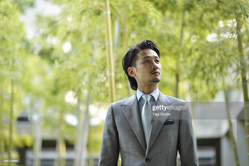 Businessman standing in the city
