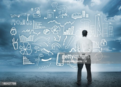 Businessman standing looking at detailed business flowchart : Stock-Foto
