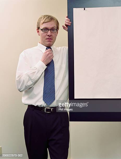 Businessman standing near board