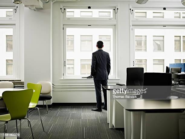 Businessman standing near window in office