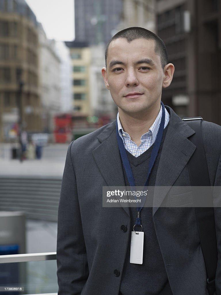 Businessman standing on city street