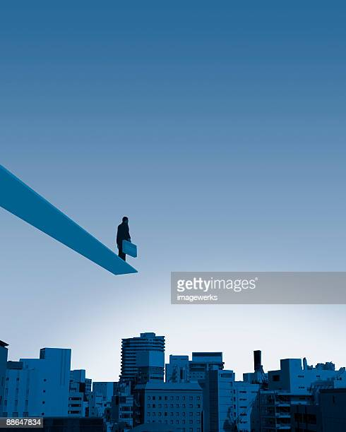 Businessman standing on diving board, low angle view (Digital Composite)