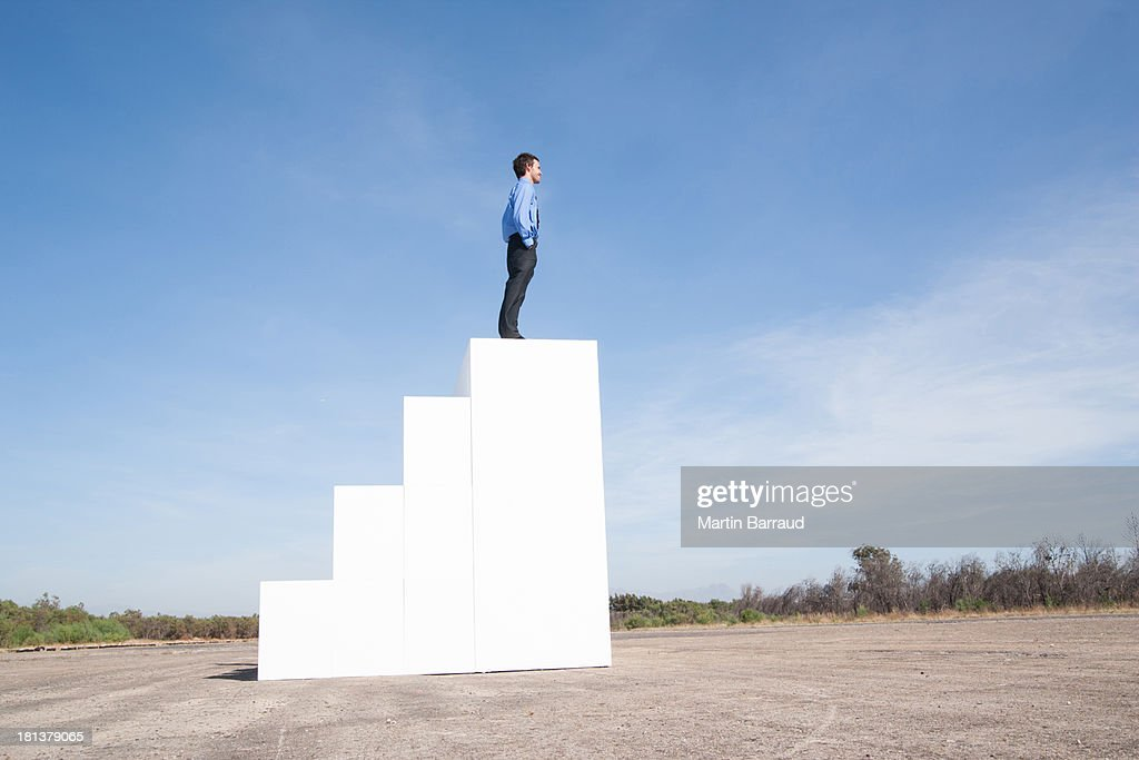 Businessman standing on steps outdoors : Stock Photo