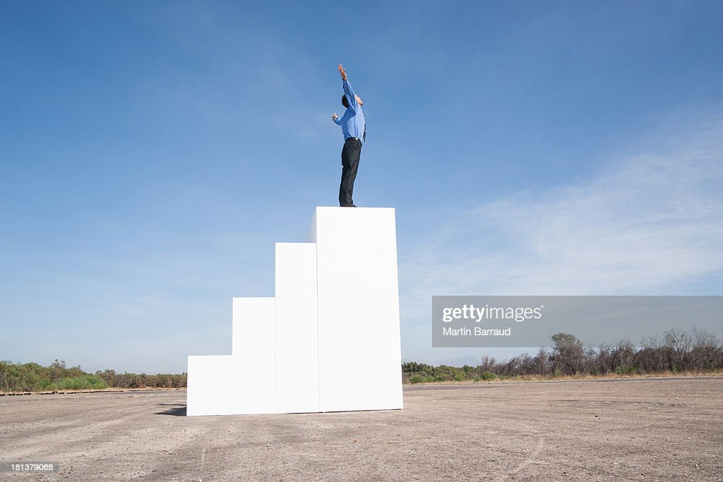 Businessman standing on steps outdoors