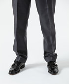 Businessman standing on the floor - closeup of legs